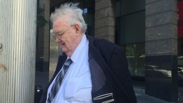 Paedophile priest Robert Flaherty leaves Downing Centre Court.