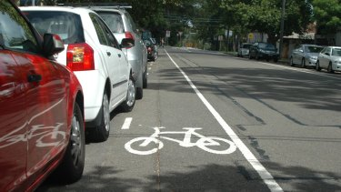 Tight squeeze: a bike lane alongside parked cars.