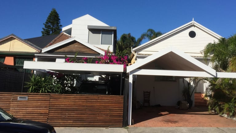 The resident of the house to the right, in Hastings Parade, North Bondi, has been charged with throwing chlorine in the face of his neighbour, who lives in the house on the left.