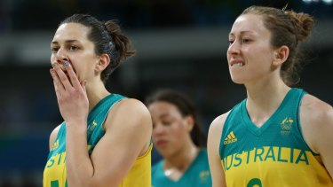 Canberra Capitals player Marianna Tolo (left) and Natalie Burton leave the court dejected after their quarter-final exit at the Olympics.