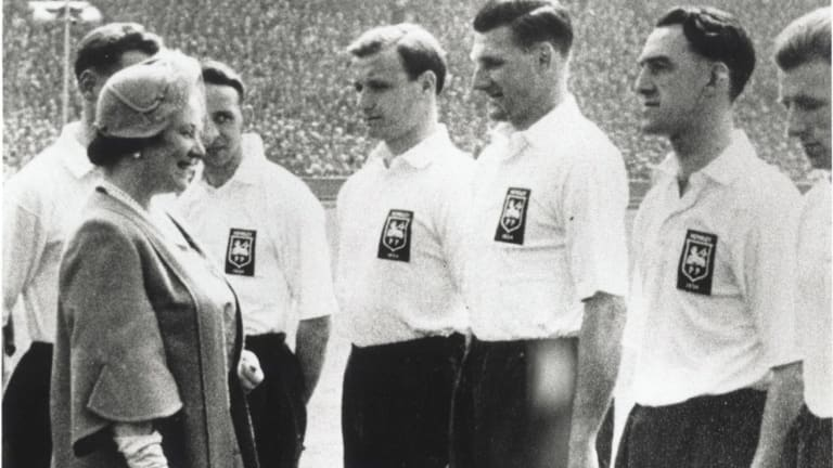 Joe Marston being presented to the Queen Mother at Wembley in 1954.
