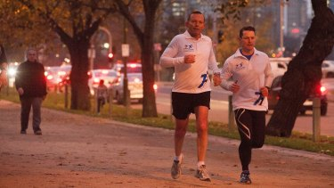 Prime Minister Tony Abbott, seen out jogging in Melbourne on Friday, said the government stopped people-smuggler boats ''by hook or by crook''.
