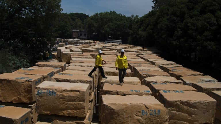 Yellow block sandstone stored at a holding yard in Pyrmont. It was harvested from a quarry in Harris Street by Bundanoon Sandstone.