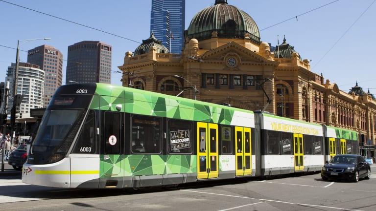 An E-Class tram on Flinders Street.