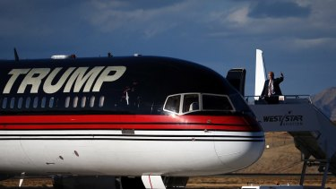 Donald Trump waves to supporters as he debarks his plane in Grand Junction, Colorado.