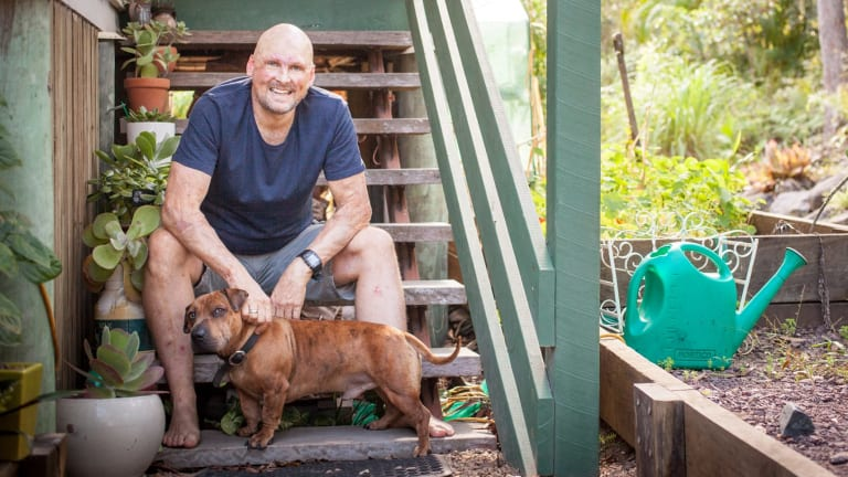 Chef Matt Golinski at his Noosa Hinterland home with his dog Duke.