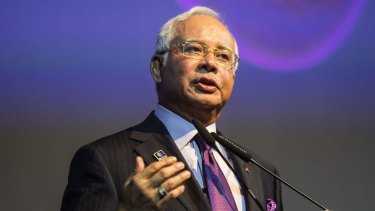 A spokesman for Najib Razak says corruption links to the Malaysian Prime Minister are 'baseless smears and insinuations'.