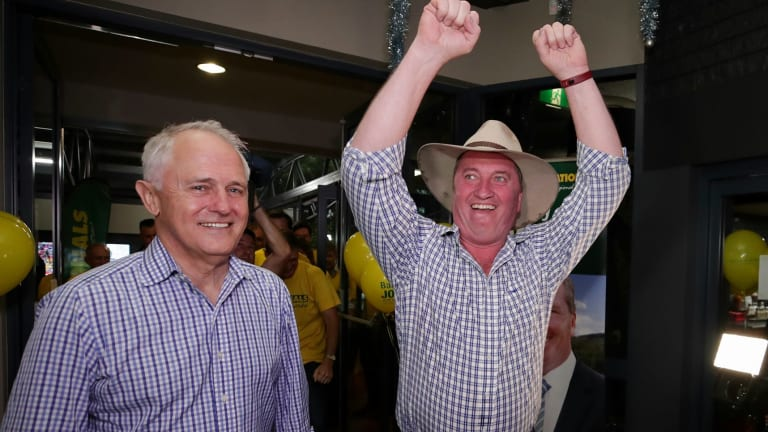 Prime Minister Malcolm Turnbull and New England candidate Barnaby Joyce celebrate at Barnaby Joyce's election night party.