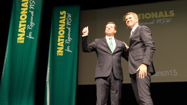 Leader of the NSW Nationals, Troy Grant, is greeted on stage by NSW Premier Mike Baird.