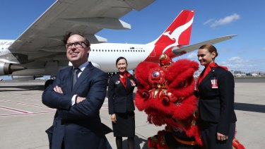Qantas chief executive Alan Joyce at Sydney Airport on Thursday where he announced the resumption of direct flights to Beijing.
