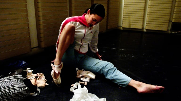 Felicia Palanca putting on her ballet shoes before evening barre class when she was with the Australian ballet.