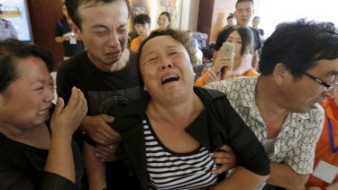 A family grieves for missing firefighter Xue Ning.