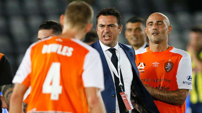 Extra time: An angry Mariners coach Paul Okon takes offence to something said after the final whistle.