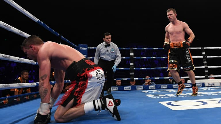 Down but not out yet: Corcoran takes a fall during the WBO world welterweight title fight.