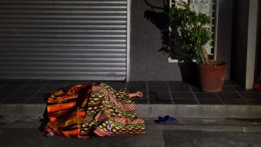 One of two people killed in a double shooting in the Manila suburb of Baclaran, lies in the street.