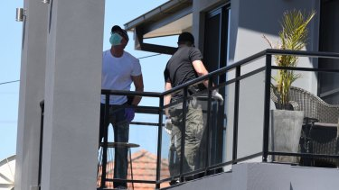 Police raid a home in Merrylands on Thursday.