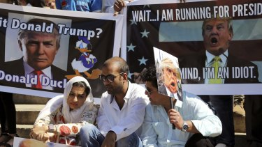 Indian Muslims hold placards during a protest against Donald Trump in Bangalore earlier this month.