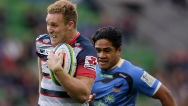 Waiting game: Reece Hodge in action for the Rebels against the Force on Sunday.