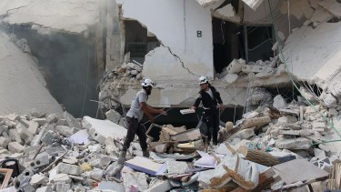 Aleppo after being hit by barrel bombs. US has doubts about Russia's intentions in Syria.
