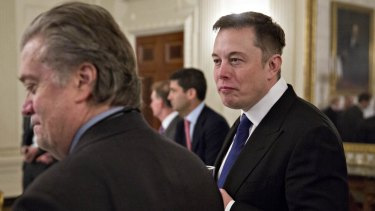 Elon Musk, co-founder and chief executive of Tesla Motors, right, and Steve Bannon, chief strategist for US President Donald Trump.