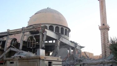 An image distributed by IS's propaganda agency Amaq shows a Raqqa mosque damaged by the coalition earlier this month.