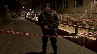 An armed police officer stands guard near the synagogue.