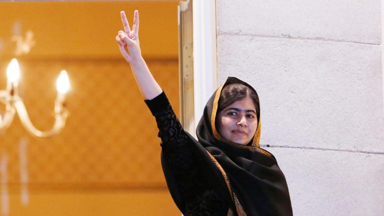 Nobel Peace Prize laureate Malala Yousafzai flashes a victory sign from the balcony of the Grand Hotel in Oslo in December last year.