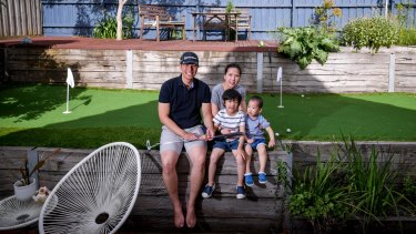 Calan Choke with wife Jan and sons Dylan and Matthew at their backyard putting green.