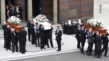 The coffins of Annabelle Falkholt and her parents Lars and Vivian Falkholt are carried out of St Mary's Catholic Church.