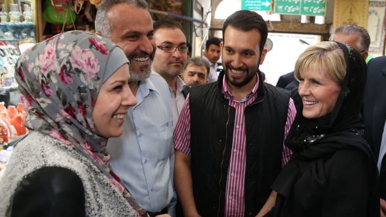 Locals flocked around Foreign Minister Julie Bishop in the crowded alleys of Tajrish bazaar.