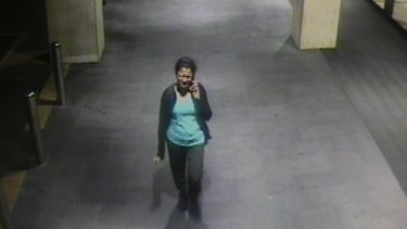 A CCTV image of Prabha Arun Kumar talking on the phone to her husband minutes before she was stabbed.