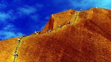 Climbers scale Uluru in the Northern Territory.