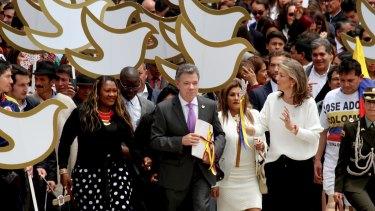 Colombia's President Juan Manuel Santos delivers the original peace deal to Congress.