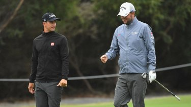 Dynamic duo: Adam Scott and Marc Leishman walk the fairway during a practice round at Kingston Heath.
