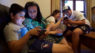 """""""Bring it on"""": Mary Boulos with her children (from left), Mikhael, Alyssa and Charvel, looks forward to the day when all the devices in her Hawkesbury home are connected."""