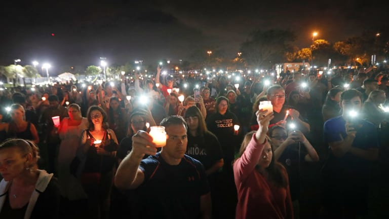 A candlelight vigil in memory of the 17 students and faculty who were killed.