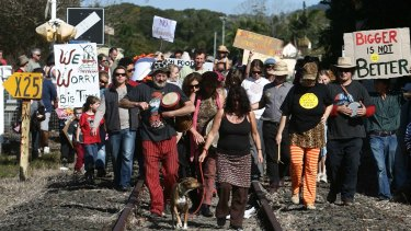 Locals march down the railway track with banners during a protest in Mullumbimby against a proposal to build a Woolworths in town in 2008.
