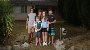 Greg Saunders and his partner Alison Hale with their children, Tom 10, and Bronte, 15. They are living in a caravan at the home of Alison's son Dylan, left.