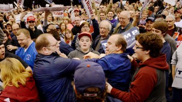 A protester, centre left, and a Trump supporter, centre right, scuffle during a rally for Republican presidential candidate Donald Trump in Ohio on March 12.