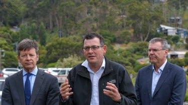 Minister for Roads Luke Donnellan, Premier Daniel Andrews and chief executive of VicRoads John Merritt at Wye River.