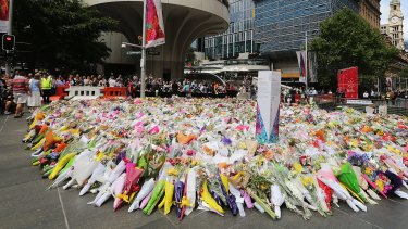 Flowers left as a mark of respect near the site where Monis took 18 people hostage during the fatal siege.