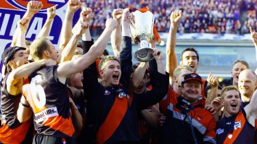 Bomber glory: Captain James Hird and coach Kevin Sheedy lift the 2000 AFL premiership cup.