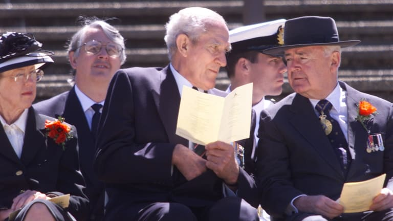 Former chair of the Australian War Memorial Major-General  William  'Digger' James (CENTRE) and the Governor-General Sir William Deane and Lady Deane during the 2000 Remembrance Day ceremony.