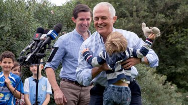 Prime Minister Malcolm Turnbull with grandson Jack Turnbull Brown and Education Minister Simon Birmingham in Double Bay.