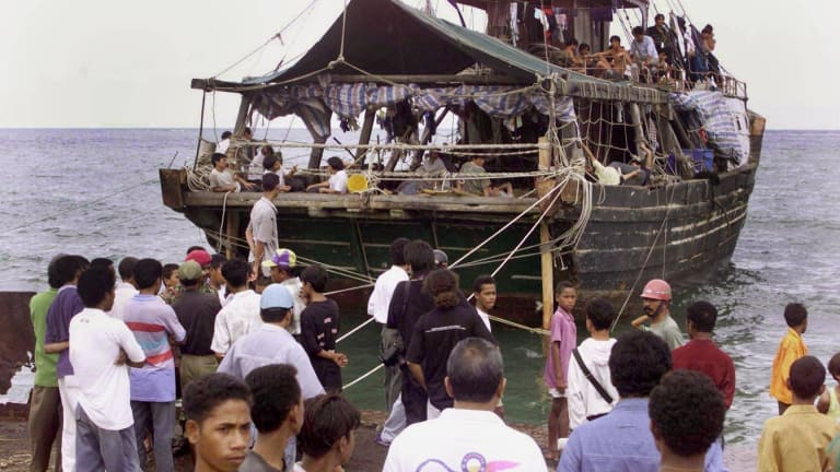 In this 1999 photo, migrants arrive in East Timor to replenish supplies, their destination believed to be Australia.
