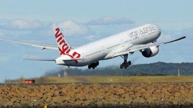 A radio hoaxer told a Virgin pilot to abort a landing.