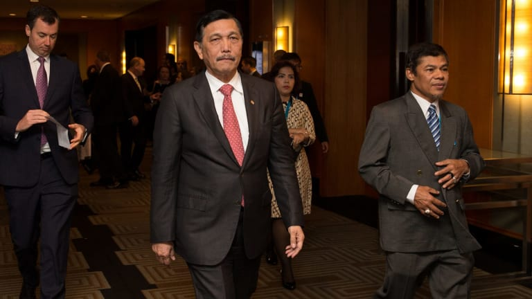 Indonesian Chief Security Minister Luhut Pandjaitan, centre, at a Counter-Terrorism Financing Summit in Sydney last month. Indonesia does not want to part of a military alliance against terrorism, he says.