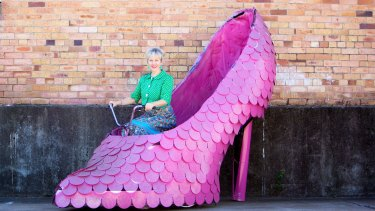 Woolloongabba Antique Centre owner Sarah Jane Walsh with the pink stiletto bicycle.