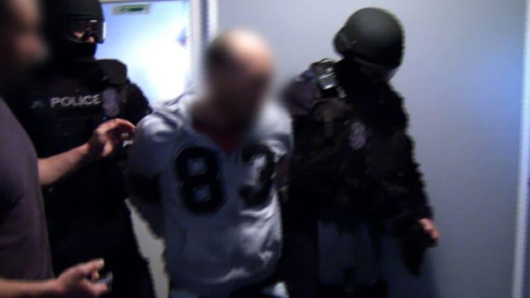 Police arrest Anslem Lee.