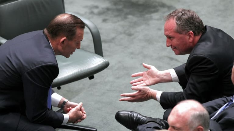 Prime Minister Tony Abbott and Agriculture Minister Barnaby Joyce in discussion.